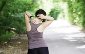 female runner stopped by neck pain