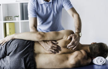 man undergoing chiropractic treatment