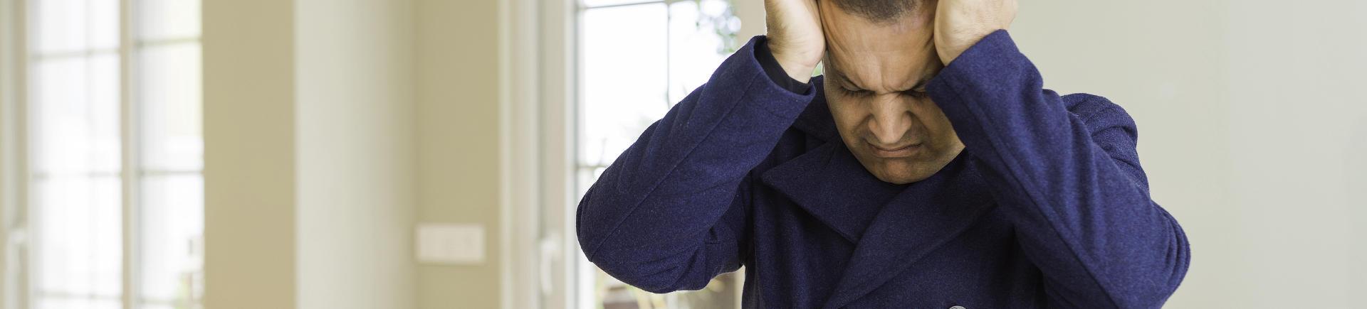 mature man suffering from severe headache
