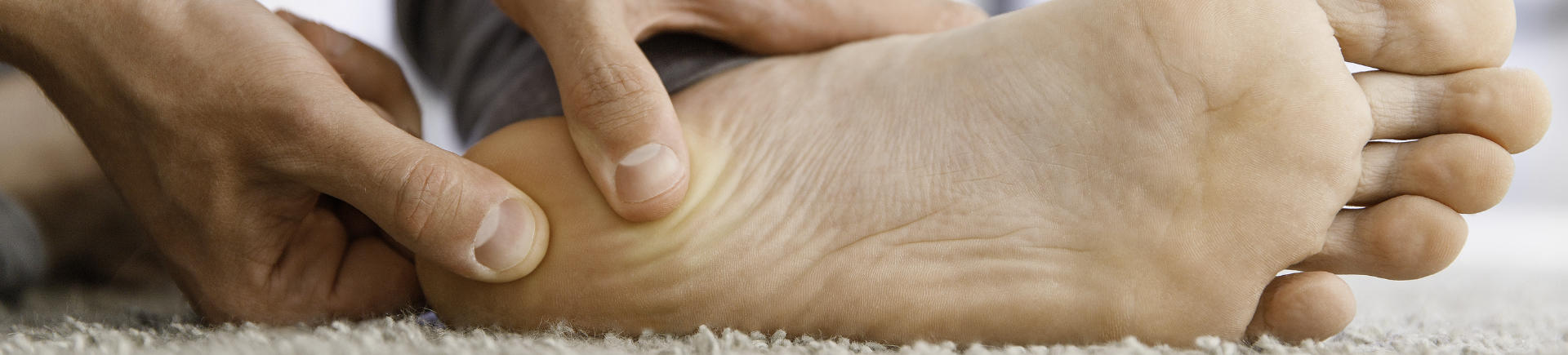 a person suffering from foot plantar fasciitis