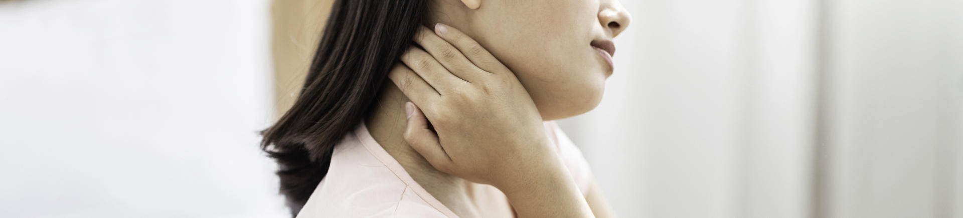 Asian woman suffering from neck pain