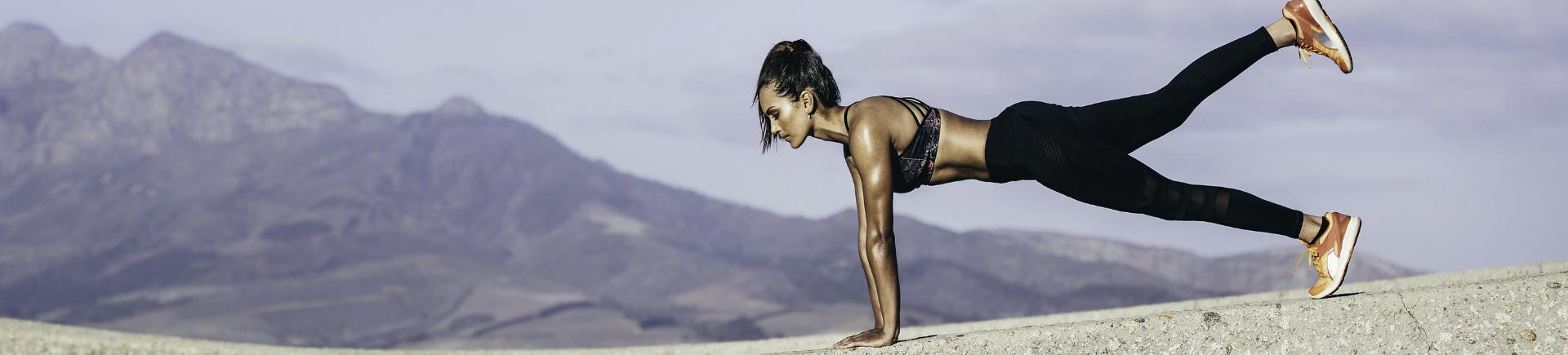fit young woman working out outdoors